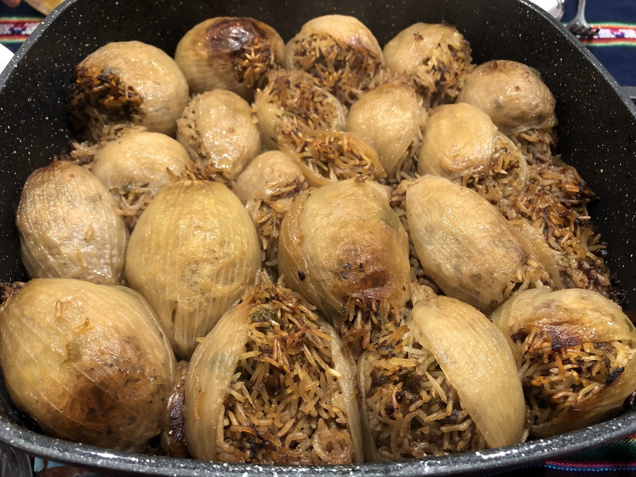 Stuffed Onions with Rice and Lamb in Pomegranate Juice
